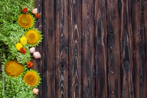 Tuinposter Bloemen Autumn background with sunflowers on wooden board. Floristic layout. Warm fall colors and sunflowers on rustic wood background
