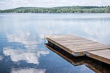 Landscape Of Wooden Dock Floating In Lake At Sweden Countryside