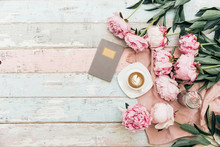 Flat Lay Cup Of Coffee And Peonies On Shabby Chic Background.