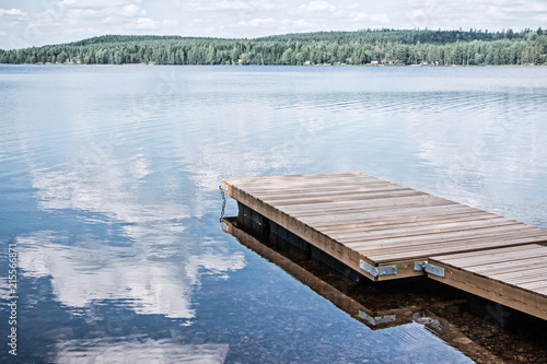 Fotografie, Tablou landscape of wooden dock floating in lake at sweden countryside