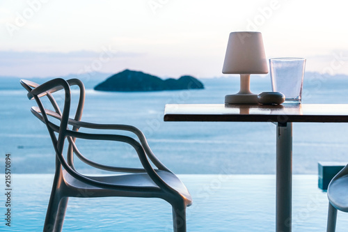 Photo  Sitting area besides the overlooking view of the Gulf of Thailand