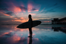 Girl With Surfboard At Sunrise