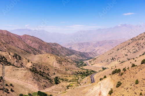 Kamchik Pass viewpoint overlooking Qurama Mountains - Uzkbekistan Wallpaper Mural
