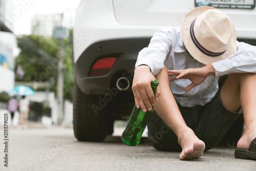 Photo  Drunk asian young man drives