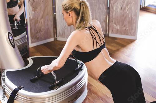 Fototapeta  Girl doing push-ups on power plate