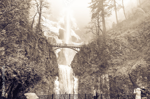 Obraz na plátne Vintage tone crowded of visitor at the main lookout of the base of Multnomah Falls in winter time