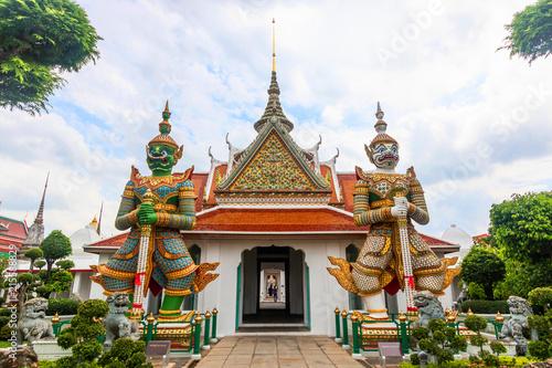 Wat Arun Ratchawararam Ratchawaramahawihan or Wat Arun buddhist temple of dawn . famous ancient grand palace in Bangkok Thailand , asian travel landmark . Tossakan and Sahassadeja ramakien yak , giant