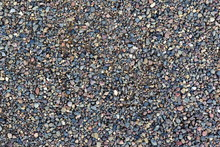 Grey Gravel Pile Closeup Photo For Background. Sharp Gray Stones In Pile For Construction. Road Or Building Construction Supply. Grey Stones Bunch For Wallpaper Or Banner Template. Natural Texture