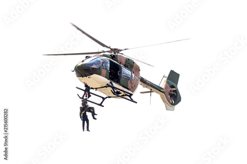 Photo  Rayong, Thailand - July 21 2018:the men lowered by a rope under a helicopter on the white background