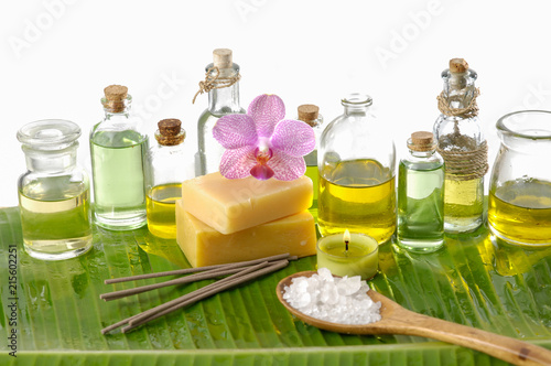 Spa setting on banana leaf with yellow orchid ,candle, salt in spoon,bottle, oil