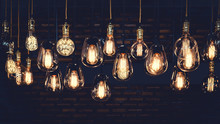 Beautiful Vintage Luxury Light Bulb Hanging Decor Glowing In Dark. Retro Filter Effect Style.