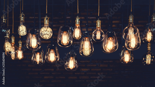 Staande foto Retro Beautiful vintage luxury light bulb hanging decor glowing in dark. Retro filter effect style.