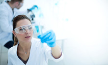 Scientists Are Conducting Research In A Modern Laboratory