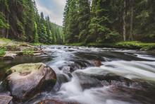 Mountain River Flowing In A De...
