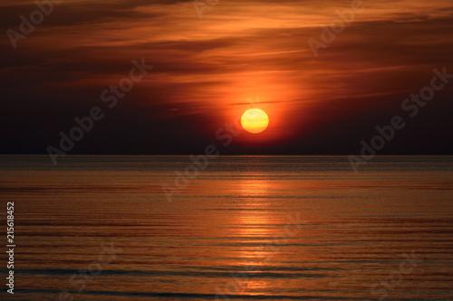 Staande foto Chocoladebruin Beatiful sunset in the baltic sea
