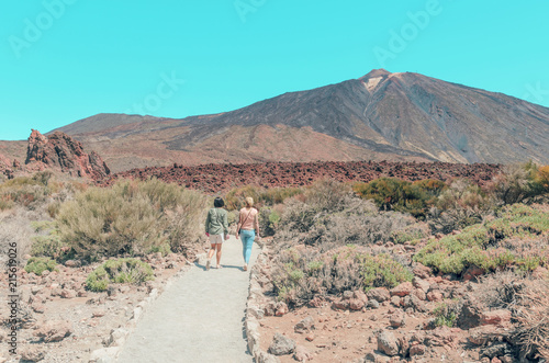 Foto op Plexiglas Turkoois Tourists walking in The National Park of Las Canadas del Teide, Canary Islands , Spain. Beautiful unearthly landscape background of Volcano El Teide.
