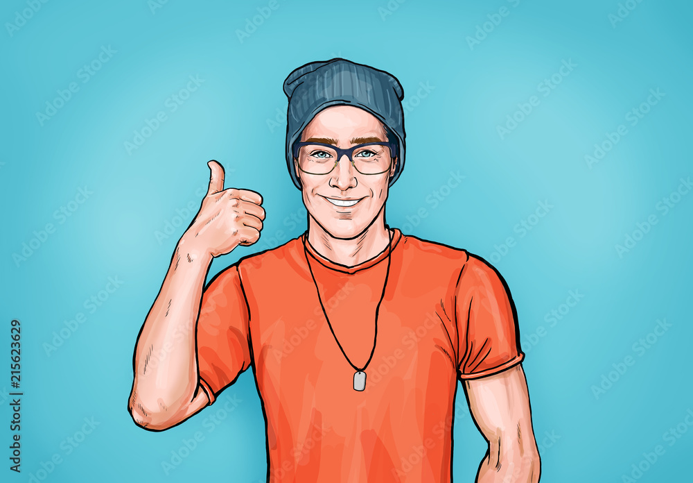 Fototapeta Smiling hipster man in glasses with Like sign. Advertising design with person that guarantees the quality of work or services. Male in orange t-shirt and hat shows thumb up.