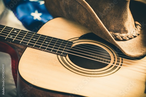 Acoustic Guitar and Cowboy Hat with American Flag on Background Canvas Print