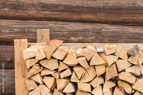 Foto op Aluminium Brandhout textuur stack of firewood on log wall background. outdoor storage of woodpile