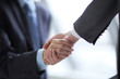 close up.business handshake on blurred office background