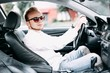 European male business car driver .. A successful young man is behind the wheel.