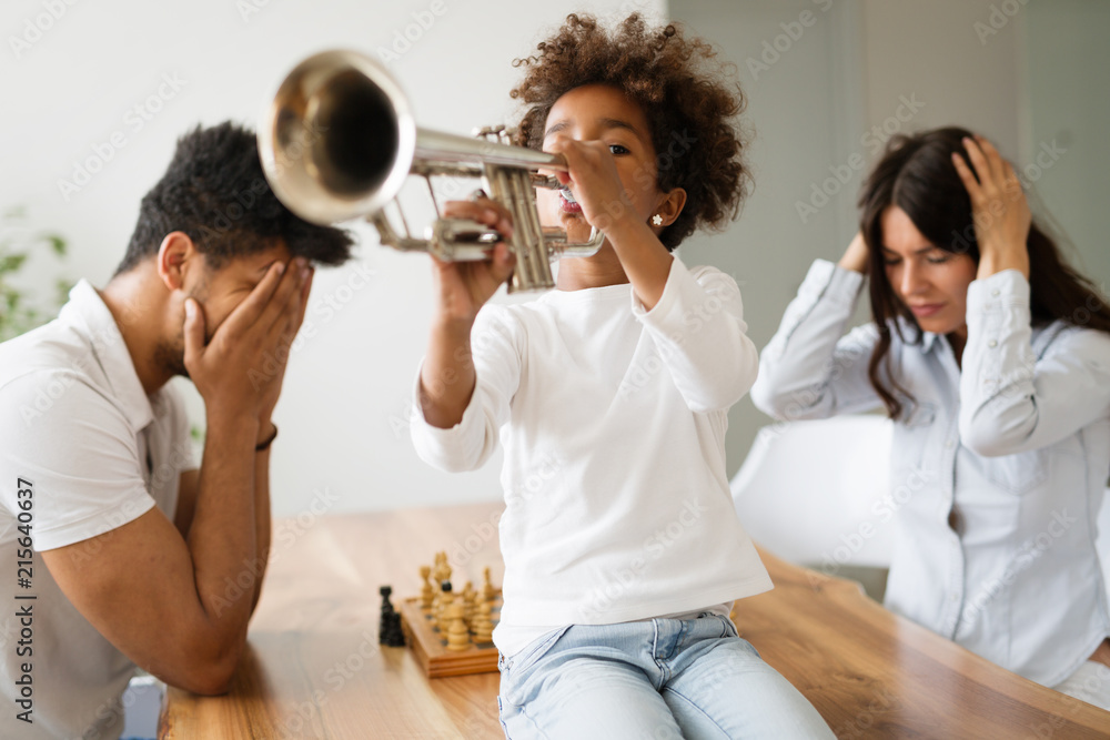 Fototapeta Picture of child making noise by playing trumpet