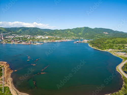 Photo  Bay in town with sink ships aerial