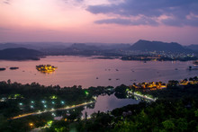 View Of Udaipur At Night From The Mountain Onto Lake Pichola