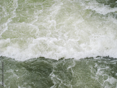 фотография  strong water current with wave.