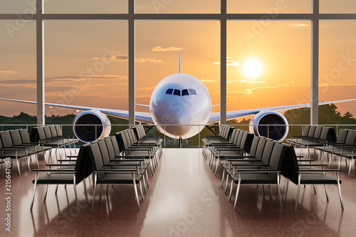 Empty airport terminal lounge and airplane in background at