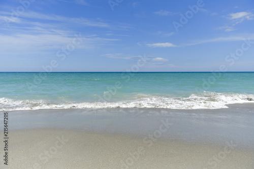 Staande foto Strand Beach, waves and blue sky