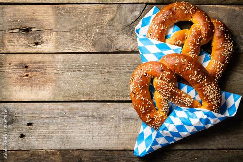 Obraz na plátně Oktoberfest concept - pretzels on rustic wood background