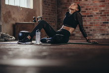 Tired Woman Taking Rest After Intense Training