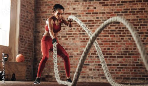 Obraz na plátně Fat burning workout in fitness studio