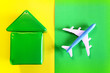 Leinwanddruck Bild - house from a colored children's cubes and airplane on a colored background