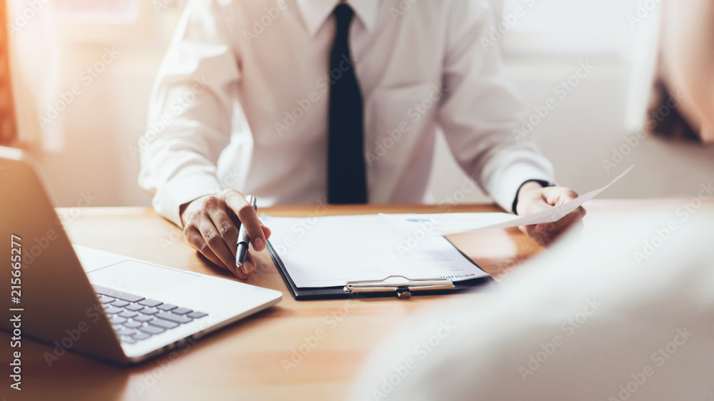 Fototapeta man submit resume to employer to review job application. The concept presents the ability for the company to agree with the position of the job.