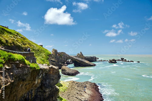 Foto op Plexiglas Kust Biarritz city and view of its the famous landmark Rocher de la Vierge, a statue of Virgin Mary on the rock. Bay of Biscay, Atlantic coast, Basque country, France. Summer sunny day with white clouds