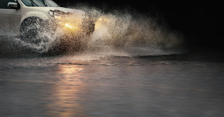 Stop motion, high resolution image of . splash by a car through flood water after hard rain.