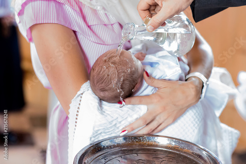 Fototapeta Baptism ceremony in Church, selective focus set