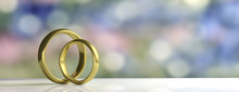 Two Golden Wedding Rings Isolated On White Table, Blur Background, Banner, Copy Space, 3d Illustration