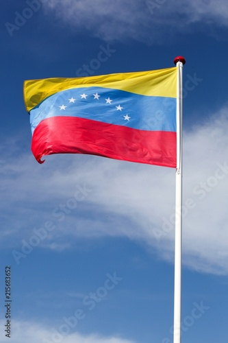 Poster Zuid-Amerika land Flag of Venezuela waving in the sky