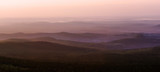 Blurred background - mountains and valleys in the dawn haze - 215684064