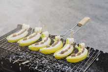 .Banana Dessert On The Grill. Bananas With Chocolate On The Coals.