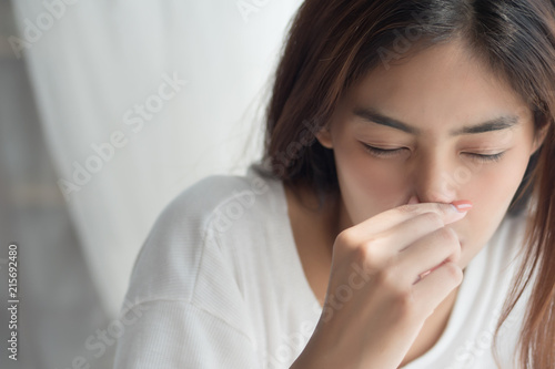 sick girl sniffle with runny nose; sick woman suffering from cold, flu, runny no Canvas-taulu