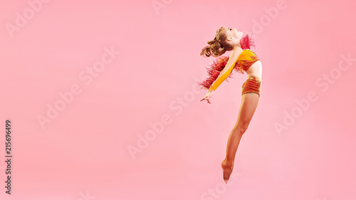 plakat Contemporary dance. A little girl performs a complex acrobatic dance. Modern dance on a bright colorful background.