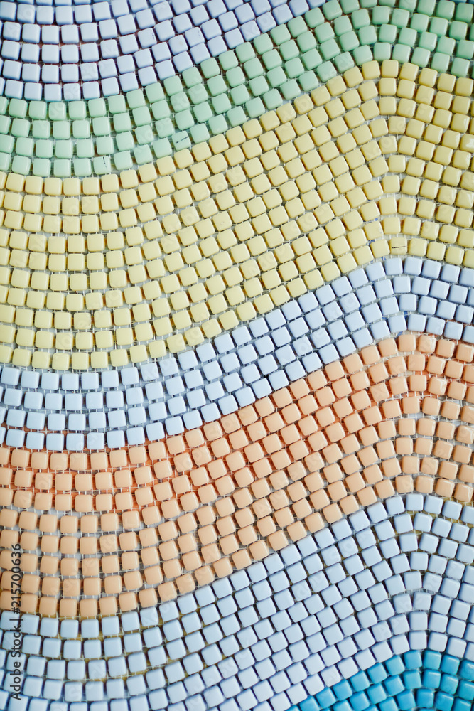 Background of pastel colored square tiles laid out in waves shape, copy space