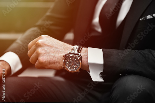 Wrist watch in a business suit. close up