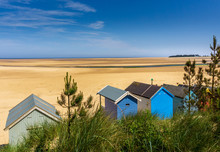 Seaside Beach Huts At Low Tide...