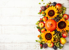 Thanksgiving Background With Autumn Pumpkins, Fruits And Flowers