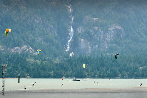 Kiteboarding, Howe Sound, British Columbia. Kiteboarders and windsurfers have almost guaranteed wind off Squamish Spit where the Squamish River empties into the head of Howe Sound.